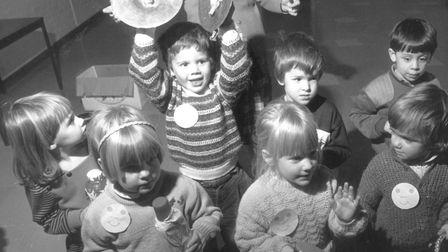 Children enjoy a din as they discover musical instruments at an under fives music group at Diss in N