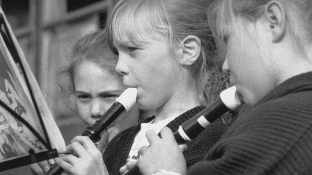 Homefield Harvest Festival - girls playing recorders in October 1991