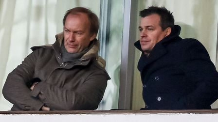 Ipswich Town's general manager of football operations watches on alongside the club's owner, Marcus
