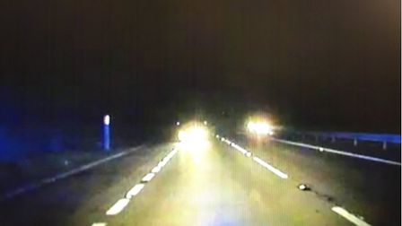 A still image from video of Remigijus Katinas driving towards a police BMW on Boxing Day Picture: S