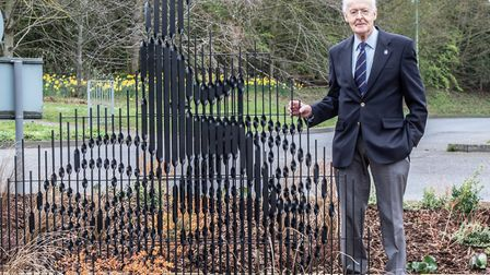 James Moore's grandson John Moore with the sculpture Picture: JO SWEETMAN