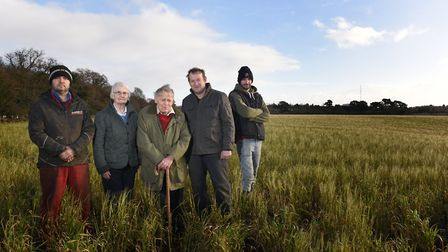 Jason Woods, Janet, Fred, John and Robert Poll in the field that is going to be affected by Sizewell