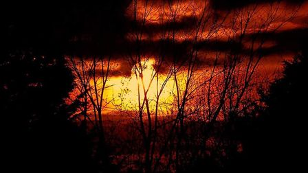 The sun setting in Sudbury Suffolk during the supermoon on March 20. Picture: MATT BYHAM
