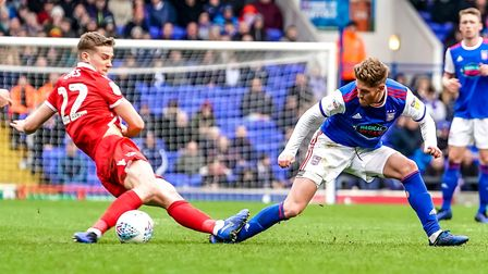 Teddy Bishop gets caught by Ryan Yates of Nottingham Forest. Picture: STEVE WALLER WWW.STEPHE