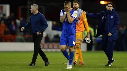 Luke Chambers reacts to the defeat at Forest after the final whistle Picture Pagepix