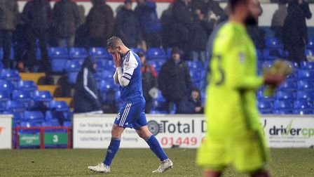 Luke Chambers leaves the pitch at the final whistle after the defeat against Derby County