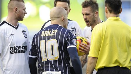 Things turn ugly between Millwall's Nicky Bailey and Luke Chambers after Carlos Edwards had the ball