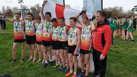 The England Schools junior boys' cross country team celebrate their victory in Dublin. The four Suff