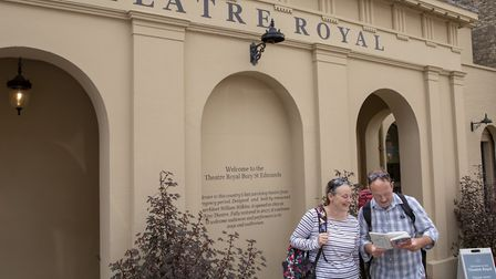 Principal walkers Dawn Roberts and Tony Kelly outside the Theatre Royal in Bury St Edmunds Picture: