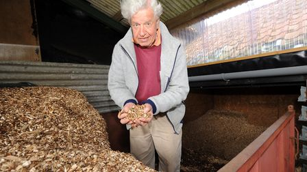 The professor with wood chips for his woodchip burner Picture: SIMON PARKER