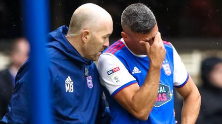 Physio Matt Byard consoles Jon Walters after his injury last September. It proved to be his last gam