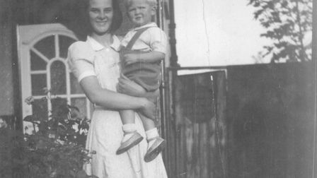 This 1942 photograph is of Margaret Thick with her first �charge� � Dennis, a neighbour�s son � when