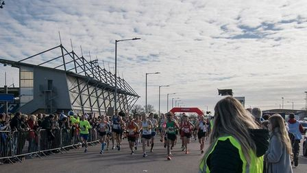 Hundreds gathered to cheer friends and family on at the start line at Colchester United FC. Picture: