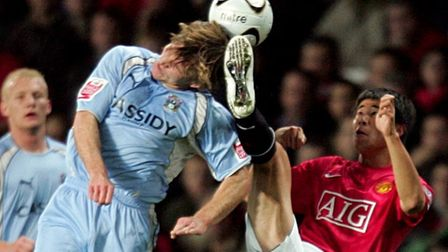 Manchester United's Fangzhou Dong (right) and Coventry City's Jay Tabb battle for the ball.