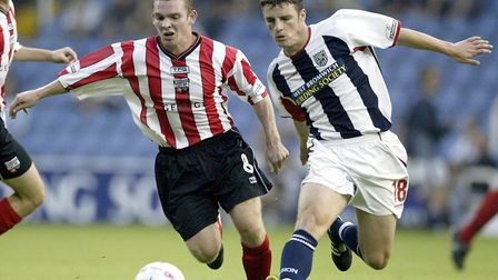 West Bromwich Albion's Jason Koumas (right) holds off the challenge from Brentford's Jay Tabb during