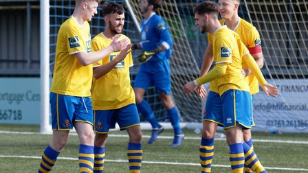 Tom Maycock celebrates one of his goals with his AFC Sudbury team- mates in their 3-1 win over Witha
