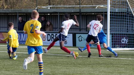 Tom Maycock (far left) gives Sudbury the lead against Witham. Picture: PAUL VOLLER