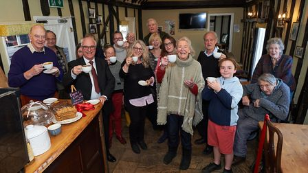 Cheers! Villagers raise a cuppa for the new cafe at the Lamarsh Lion Picture: PUB IS THE HUB