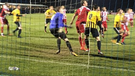 Goalmouth action as Stowmarket keeper Callum Robinson prepares to deal with a cross, with Felixstowe