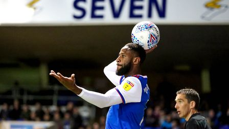 Janoi Donacien looks for options as he gets ready to throw-in in the game against Middlesbrough.