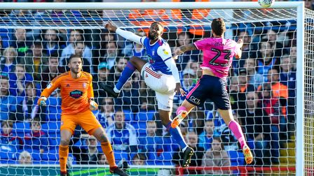 Janoi Donacien beats Pawel Wszolek to head the clear against QPR. He's not played for Ipswich since.