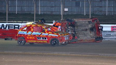 Saxmundham's Charlie Morphey takes a tumble in the 1300 Stock Cars racing at Foxhall. Picture: CHRIS