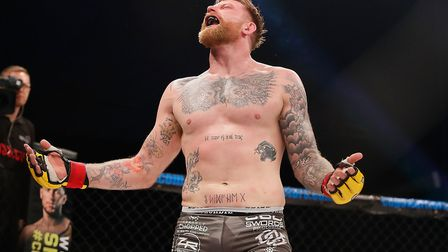 James Webb celebrates winning the Cage Warriors title against Thomas Robertsen. Picture: DOLLY CLEW