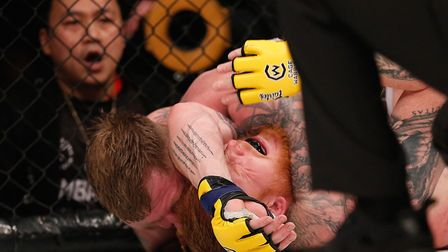 James Webb locks the fight-ending arm triangle choke in on Thomas Robertsen at Cage Warriors 102. Pi