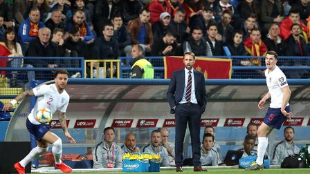 Gareth Southgate (centre) looks on as Kyle Walker (left) and Michael Keane are in action during the