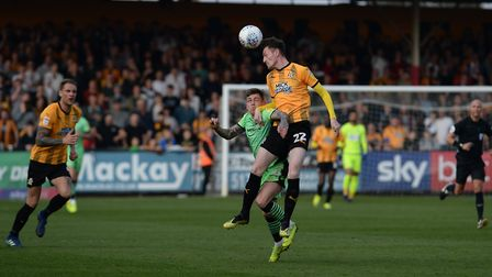 Sammie Szmodics is beaten to the ball at Cambridge this afternoon. Picture: PAGEPIX