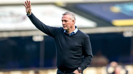 Town manager Paul Lambert turns and waves at the North Stand fans, before leaving the pitch, followi