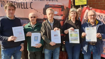 Campaigners hand over their responses to Sizewell C stage 3 consultation at the Leiston office of ED