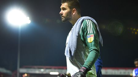 Bartosz Bialkowski leaves the pitch after Ipswich Town's FA Cup defeat at Accrington Stanley. Photo: