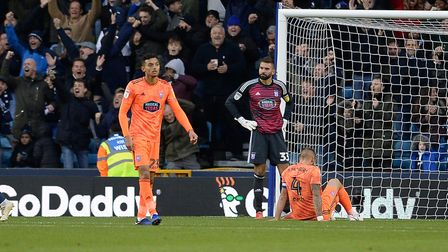 Andre Dozzell, Bartosz Bialkowski and Luke Chambers after Ipswich had conceded a third goal Millwall