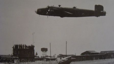 Home base: a Halifax bomber of the type flown by Cyril Barton on his fateful final mission flies low