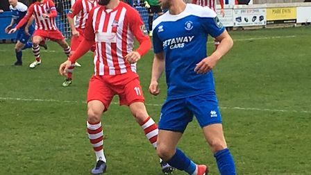 Bury Town midfielder Ryan Horne, in action during against leaders Bowers & Pitsea, faces a fitness t