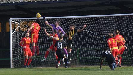 Needham keeper Jake Jessup punches clear at Rushall Photo: BEN POOLEY