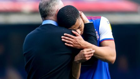Town manager Paul Lambert embraces Myles Kenlock after the final whistle. Picture: STEVE WALLER