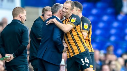 Kamil Grosicki embraces Hull manager Nigel Adkins after scoring to give them the lead. Picture: S