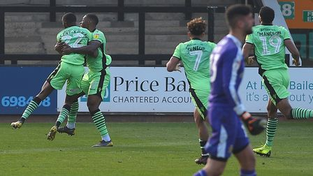 Kane Vincent-Young is about to be mobbed by team-mates after scoring an injury-time winner at Cambri
