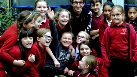 Chloe with choir leader Tom Rampley and the Hardwick Primary School choir Picture: ANDY ABBOTT