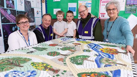 Bishops Mike Harrison and Martin Seeley get a sneak preview of the �Vision mosaic� at Walsham le Wil