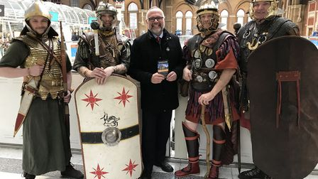 Councillor Tim Young with Roman actors at Liverpool Street Station Picture: Colchester Borough Coun