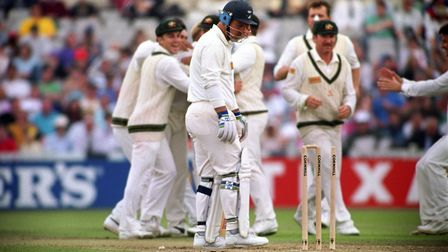 England's Mike Gatting (centre) is bowled out by Shane Warne's first delivery of the day at Old Traf
