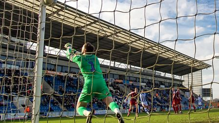 Tranmere keeper Scott Davies pushes an Abo Eisa free-kick onto the inside of the post, after 70 minu