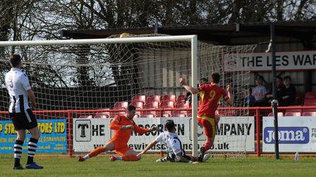 Jamie Griffiths buries the ball to make it 1-0 to Needham. Picture: BEN POOLEY