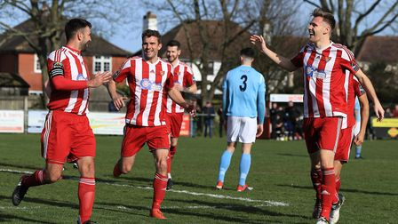 Felixstowe goalscorer Rhys Barber (left) is congratulated by Seasiders team mates. Picture: STAN BAS