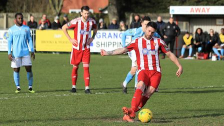 Jack Ainsley strokes home from the penalty spot to make it a comfortable 3-0 win for the Seasiders a