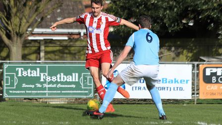 Tricky footwork from Seasiders Joes Francis as he faces up to Brentwood's John Easterwood. Picture: