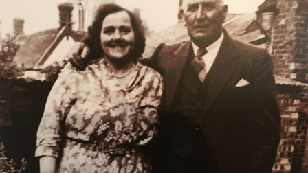 Emily and Fred Wilding in about 1950. Note the church in the background - a landmark common to many